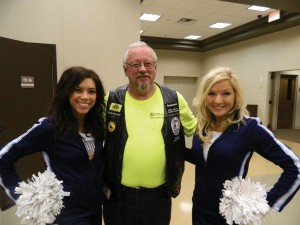 Two Oklahoma City  Thunder cheerleaders are shown here with Stephen Hale. They came by to wish bikers good luck before they left on their ride to raise money for Chapel Hill's Mother's Day-Out.