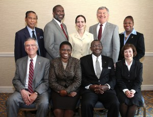 Seated, from left: Belton Joyner, J. Kabamba Kiboko, N. Oswald Tweh Sr., and Kathi Austin Mahle. Standing from left: Ruben T. Reyes, Dennis Blackwell, Beth Capen, William B. Lawrence and Angela Brown. A UMNS photo by Kathleen Barry