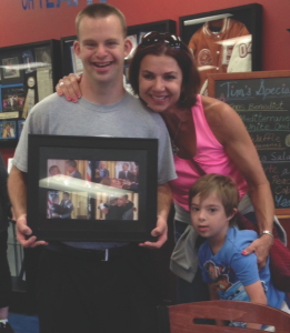 """The Watson family with Tim Harris, owner of """"Tim's Place"""" in Albuquerque, New Mexico – the only restaurant owned and operated by a man with Down syndrome.  Photos courtesy of the Watson family."""