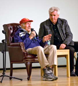 Louis Zamperini (left) with his son, Luke, answer questions during resilience training during the Wingman Day event held at the Base Theater Dec. 10, 2012. (U.S. Air Force photo by Edward Cannon)