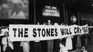1992 – Protesters unfurl banner during General Conference.