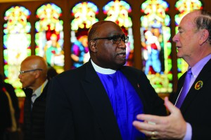 Bishop Gregory Palmer (left) speaks with the Rev. Donald E. Messer at AIDS event. Photo by Kathleen Barry, UMNS.