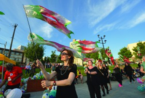 Members of KEFAS, a choir from Denmark, parade with silk batik salmon windsocks during a climate vigil outside the 2016 United Methodist General Conference. Photo by Paul Jeffrey, UMNS.