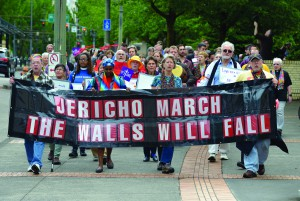 Rights activists march around the Oregon Convention Center, the site of the 2016 General Conference. The demonstrators were demanding that the church be more inclusive of LGBTQ people in its ministries. Photo by Paul Jeffrey, UMNS.
