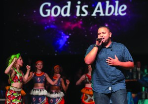 "Jeremy Rosado sings ""Able"" during a celebration of the Imagine No Malaria campaign at the 2016 General Conference."