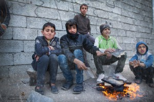 With nowhere to stay, Assyrian children try to keep warm during Iraq's long winder. Jeff Gardner, Picture Christians Project, www.picturechristians.org.