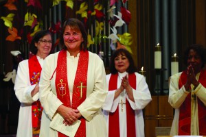 Newly elected Bishop Karen Oliveto, a married Lesbian who has become the first openly gay bishop in United Methodism, stands with Bishop Elaine Stanovsky, left, and Bishop Minerva Carcano. Photo by Charmaine Robledo, Mountain Sky Episcopal Area.