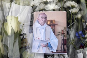 Flowers are left in tribute to Father Jacques Hamel who was murdered during a church service in France. Associated Press.