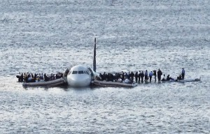 Survivors of U.S. Airways flight 1549 wait for rescue on the wing. Photo by Associated press.