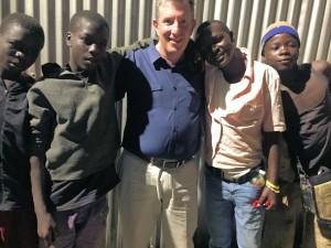 """The Rev. Max Wilkins with """"street boys"""" of Kisumu, Kenya."""